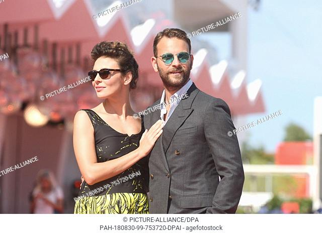 29.08.2018, Italy, Venice: The actors Alessandro Borghi and Jasmine Trinca can be seen at the opening of the film festival on the red carpet at the Lido