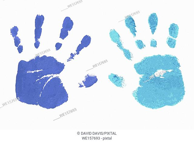 Colorful blue handprints handpainted by children isolated on a white background