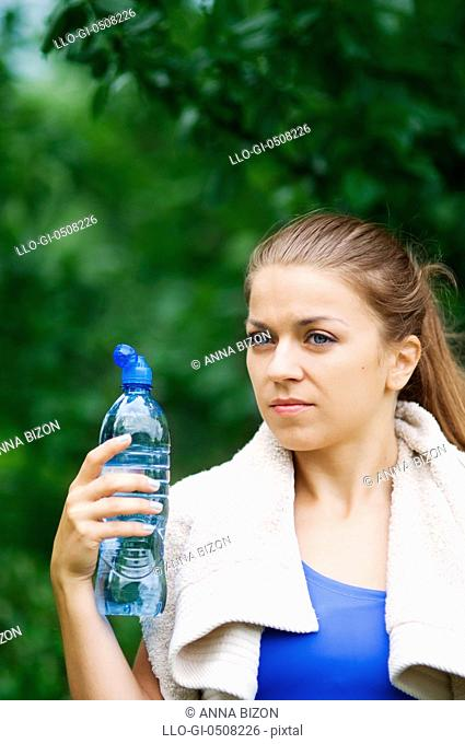 Young woman holding water bottle Debica, Poland