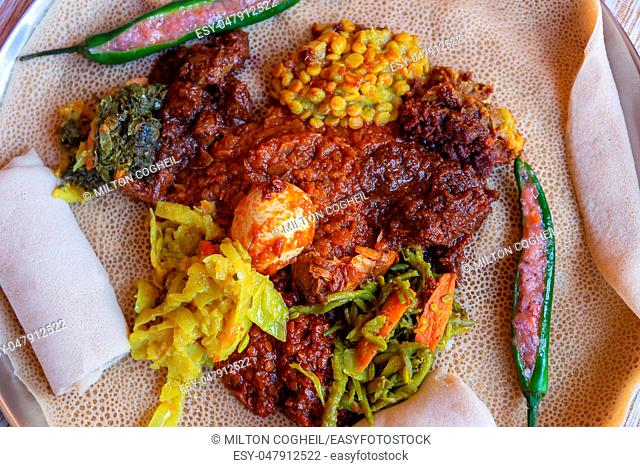 Injera served with Chicken and egg Doro Wat, berbere, vegetables and lentils. Injera, the national dish of Ethiopia, is a sourdough flatbread made from teff...
