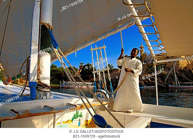 On a felucca on the Nile river at Aswan, Egypt