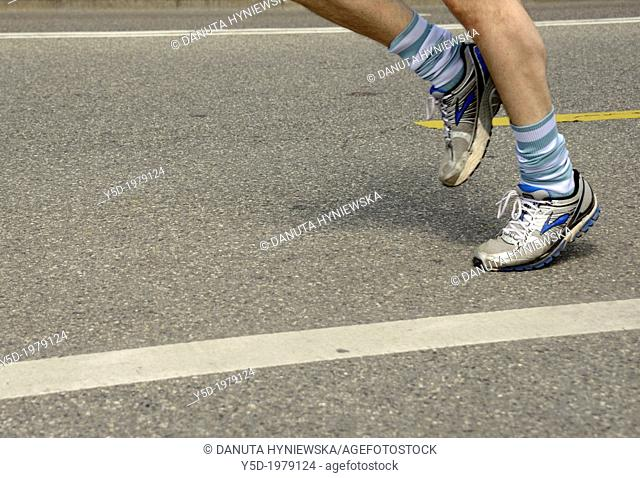 close-up of men's legs running, street of Geneva, marathon run, Geneva, Switzerland