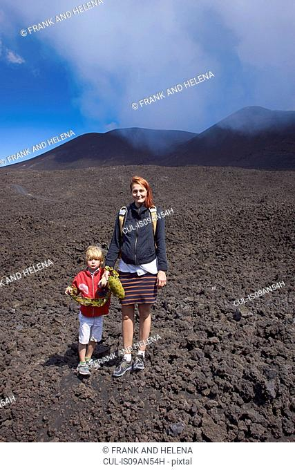 Portrait of woman and son on Mount Etna, Catania, Sicily, Italy