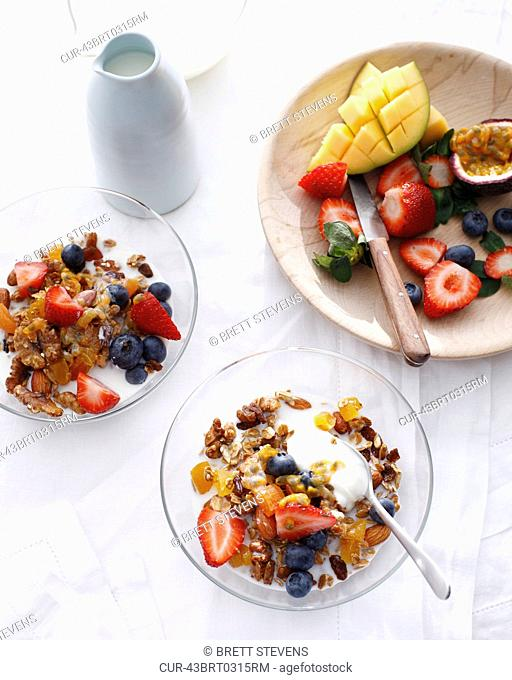 Bowls of apricot granola with fruit