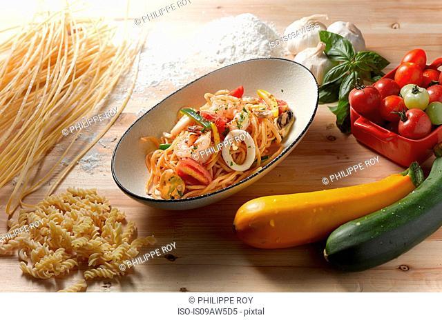 High angle view of spaghetti scoglio in oval serving dish