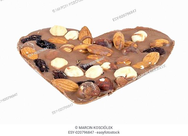 Heart shaped chocolate with nuts on white background