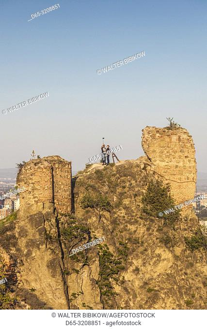 Georgia, Tbilisi, Narikala Fortress, visitors on fortress walls, NR