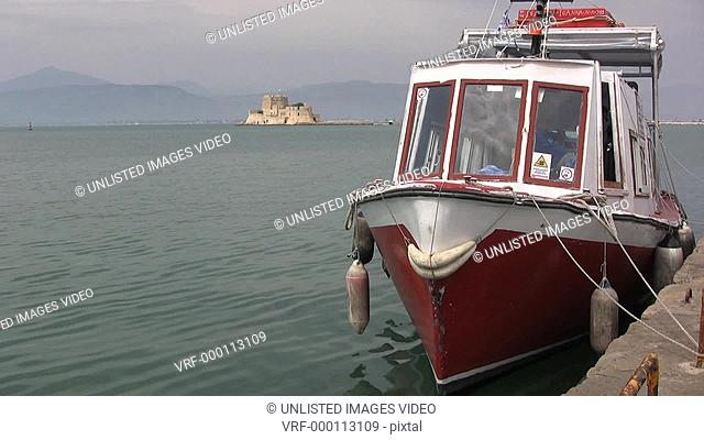 Greece Nafplion waterfront with boat
