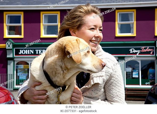 A woman with her golden retriever, allihies county cork ireland