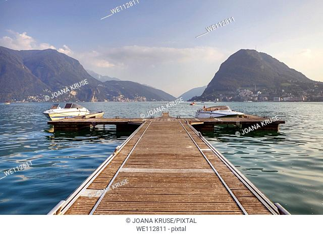 an impressive boat dock on Lake Lugano, with views of Monte Salvatore