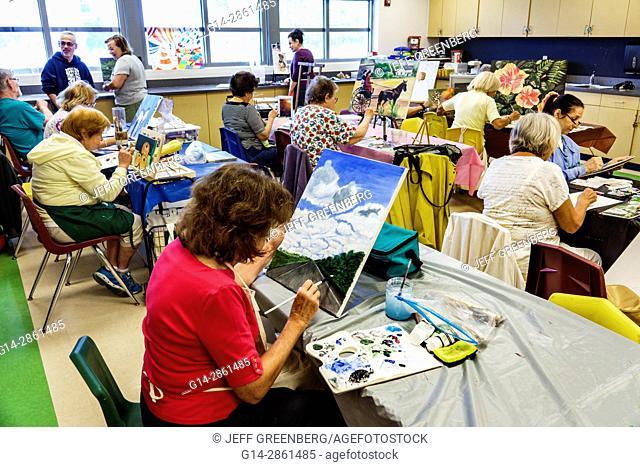 Florida, Miami Beach, North Shore Community Center, senior education, older adults, seniors, art class, canvas, painting, paintbrush, palette, woman, landscape