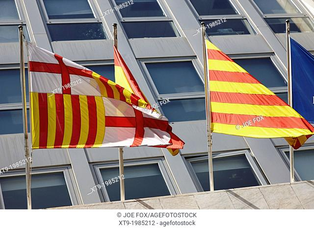 barcelona spain catalonia flags flying on a building