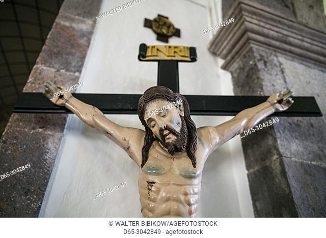 Portugal, Azores, Sao Jorge Island, Norte Grande, Igreja Nossa Senhora das Neves church, crucifix with Jesus Christ