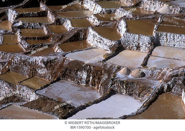 Salt production by evaporation on a mountain slope at Pichingote, the salt terraces were already in use during the time of the Incas, southern Peru