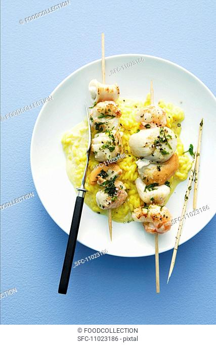 Seafood kebabs on a bed of saffron risotto
