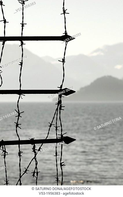 Barbed wire and sharp metal spikes, Lake Como, Italy