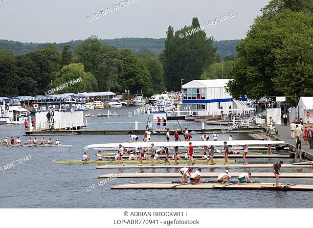 England, Oxfordshire, Henley-on-Thames, Boat crews preparing to race at the annual Henley Royal Regatta