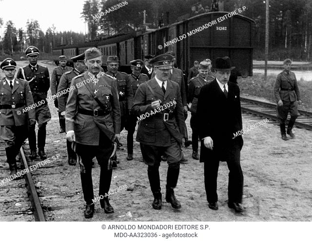 Adolf Hitler, Risto Ryti and Carl Gustaf Mannerheim. Adolf Hitler with his press agencys chief Otto Dietrich and his field marshal Wilhelm Keitel on his...