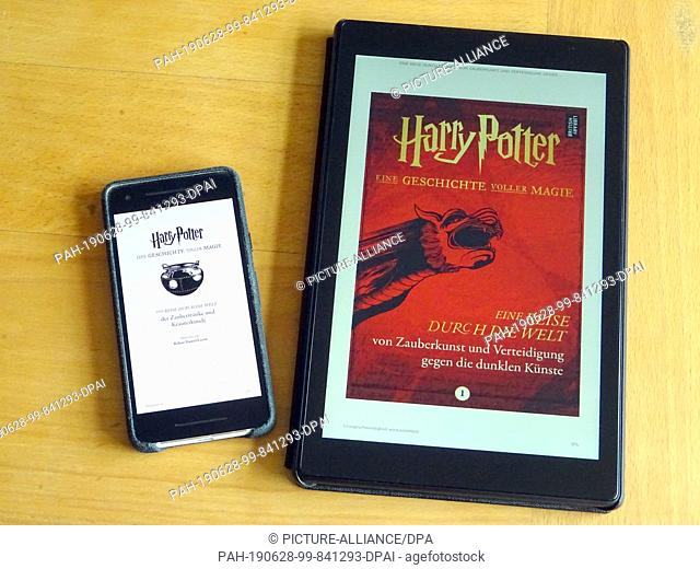 """28 June 2019, Great Britain, London: The eBook series """"""""A story full of magic"""""""" can be seen on the displays of a smartphone and tablet"""
