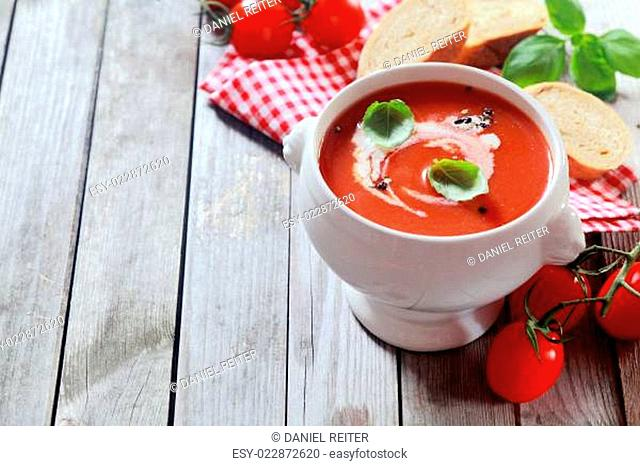 Tasty tomato soup with fresh basil and cream
