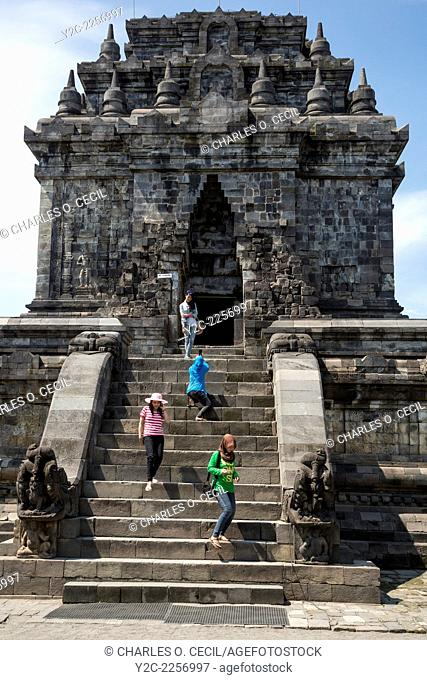 Borobudur, Java, Indonesia. Mendut Buddhist Temple. Indonesian Women Descending, and Taking Photos