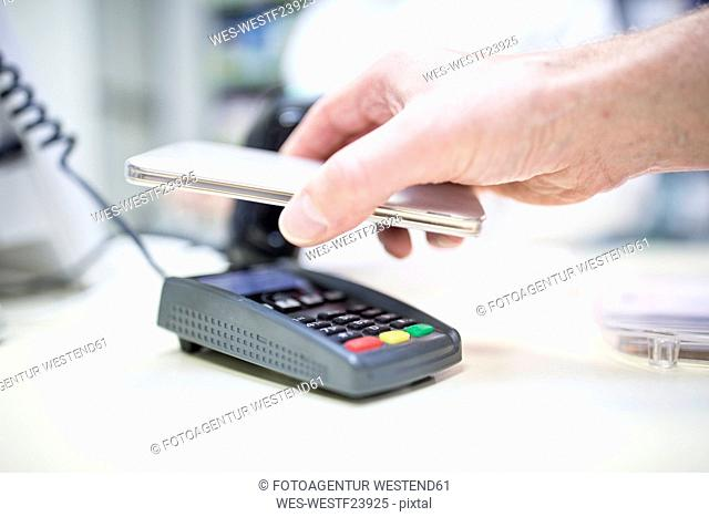 Mobile payment at shop counter