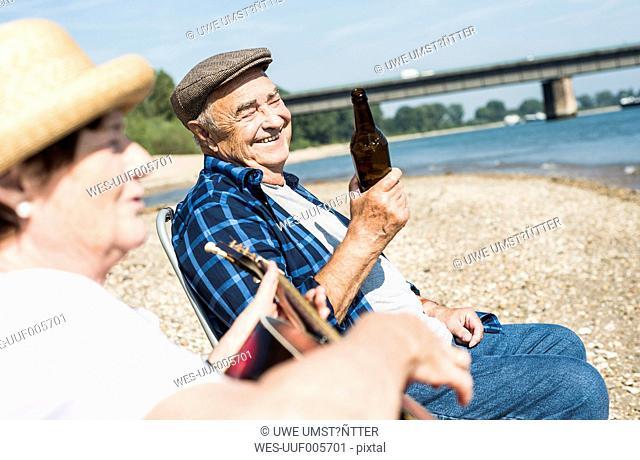 Germany, Ludwigshafen, portrait of senior man having fun at riverside