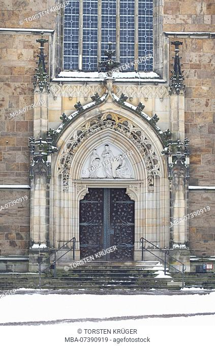 Side entrance, portal, St. Peter's Cathedral with snow, Bremen, Germany