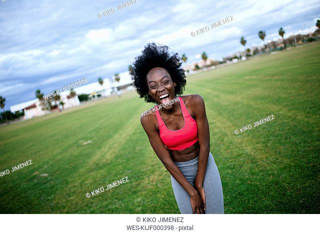 Laughing black athlete, portrait