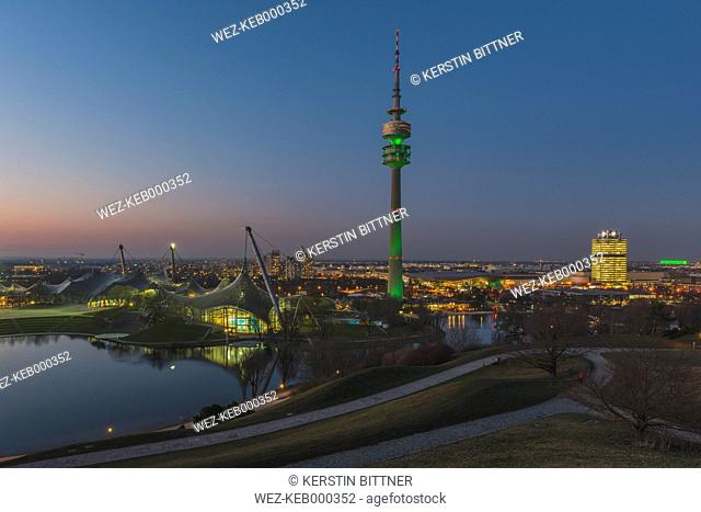 Germany, Munich, Olympic Park, Olympic Tower and BMW Tower right, St. Patrick's Day in the evening