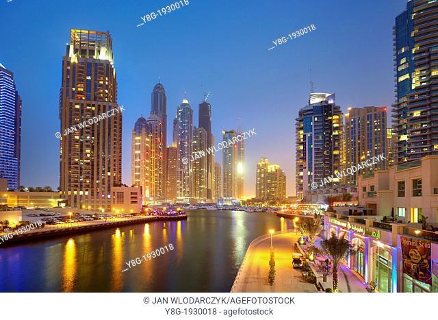 Dubai Marina by night, promenade and modern skyscrapers on the canal, Dubai, United Arab Emirates