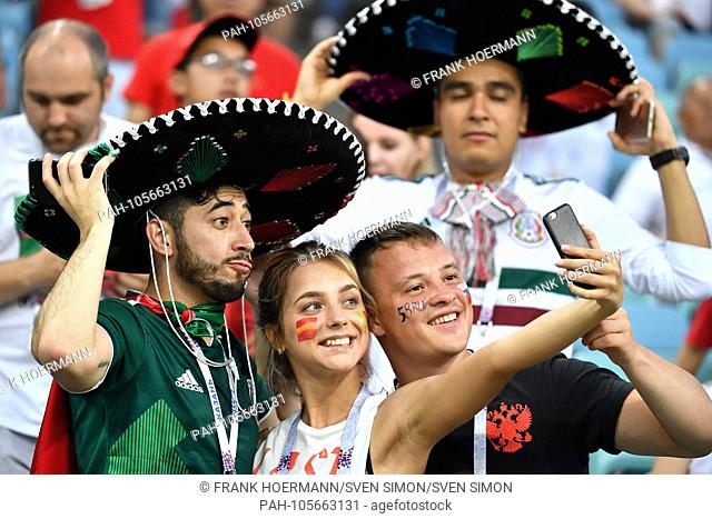 Mexican fans, football fans take selfies with young woman. Portugal (POR) - Spain (ESP) 3-3, Preliminary Round, Group B, Game 1, on 15.06