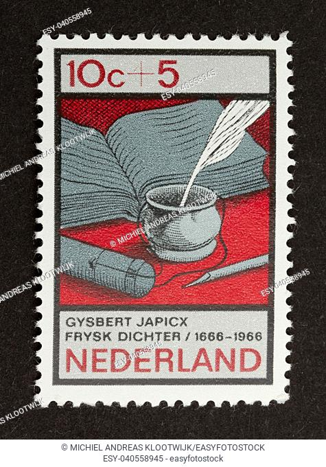 HOLLAND - CIRCA 1960: Stamp printed in the Netherlands shows a book and an old pen, circa 1960