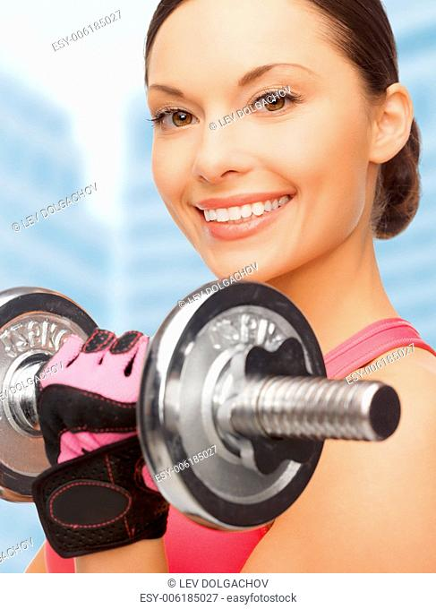 sport, fitness and healthcare concept - beautiful asian sporty woman with heavy dumbbell