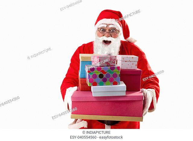 Portrait of surprised Santa Claus with Christmas presents over white background