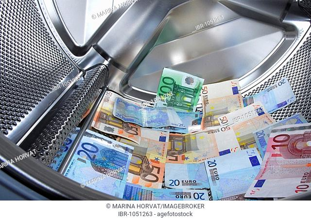 Money laundering in washing machine Stock Photos and Images