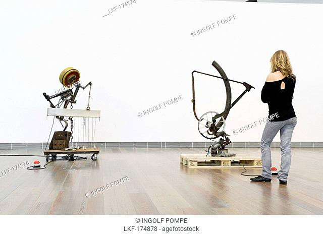 Young woman looking at sculptures in the Jean Tinguely Museum, Basel, Switzerland