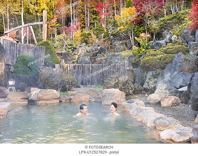 Mature Couple Bathing in Hot Spring