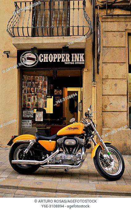 Harley-Davidson Sportster Low parked at the door of Chopper Ink Tattoo Studio, Tarragona. Catalonia, Spain