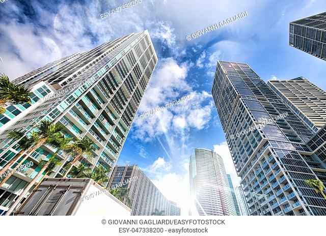 Upward street view of Downtown skyscrapers on a beautiful sunny day. Business and coroprate concept