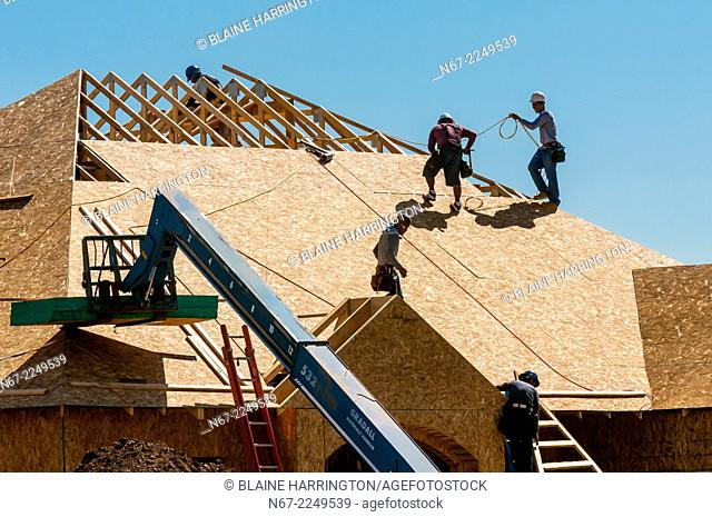 Construction workers building a new house, Littleton, Colorado USA