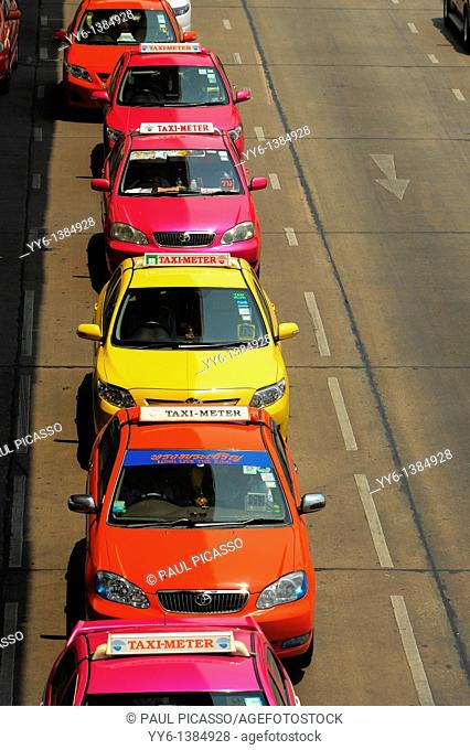 colourful taxis in a line , bangkok street , thailand
