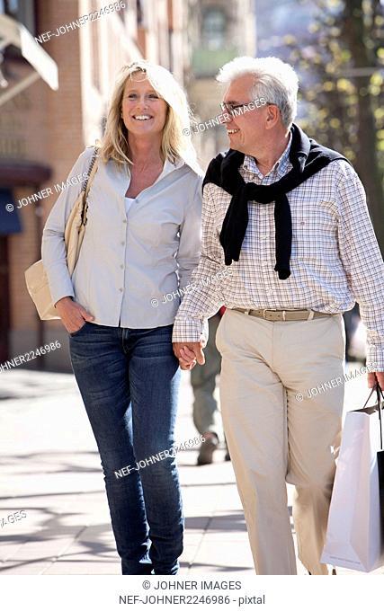 Mature couple walking on street