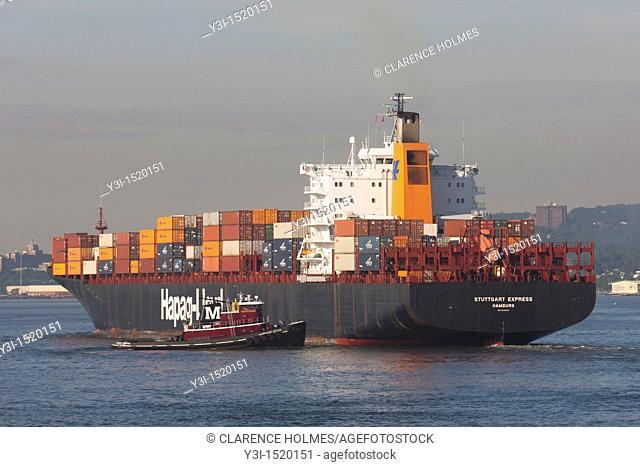 Cargo ship Stuttgart Express in New York Harbor assisted by tugboat Margaret Moran, New York City, New York, USA