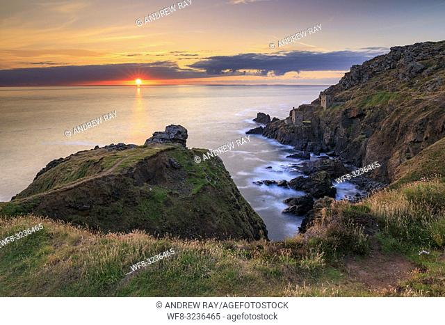The setting sun captured in mid July from the clifftop above De Narrow Zawn at Botallack in Cornwall. . A long shutter speed was utilized to blur the movement...