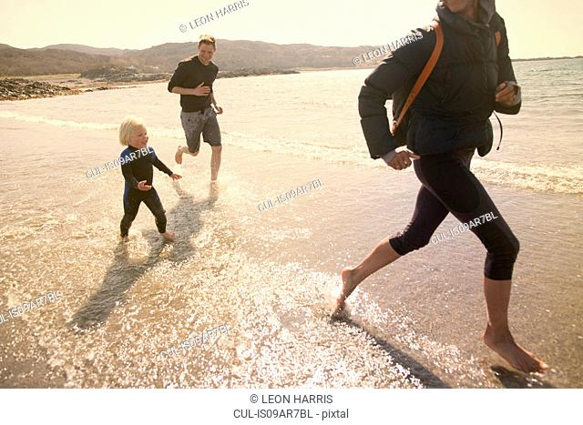 Family running on beach, Loch Eishort, Isle of Skye, Hebrides, Scotland