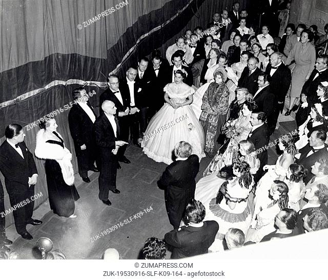 Sep 16, 1953 - Munich, Germany - SCHLANGE SCHOENINGEN addresses the cast of the Bavarian state Opera after their successful opening at the Covent Garden Opera...