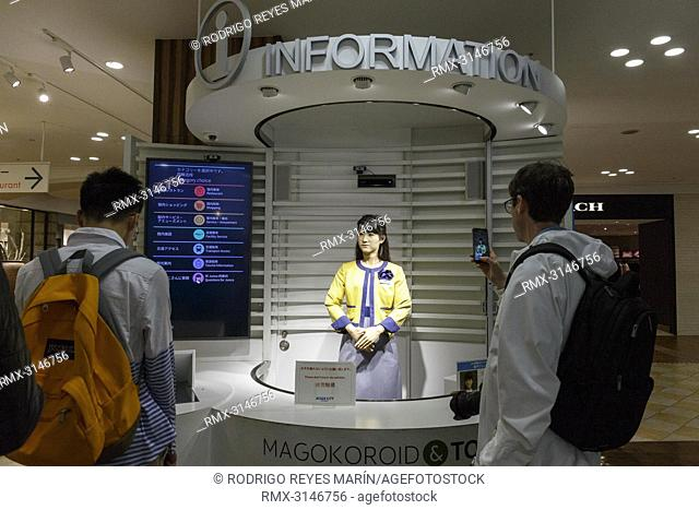 September 26, 2018, Tokyo, Japan - Visitors take pictures of humanoid robot Junko Chihira working at an information center at Aqua City Odaiba