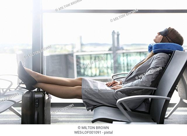 Businesswoman sleeping at the airport