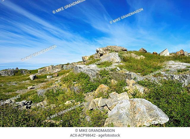 Rocky, barren landscape and clouds Iles aux Morts Newfoundland & Labrador Canada